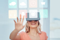 Woman in virtual reality headset or 3d glasses Royalty Free Stock Photography