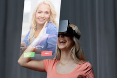 Woman in virtual reality headset or 3d glasses Royalty Free Stock Images
