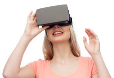Woman in virtual reality headset or 3d glasses Stock Images