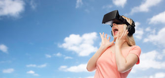 Woman in virtual reality headset or 3d glasses. Technology, virtual reality, entertainment and people concept - happy young woman with virtual reality headset or Stock Photography
