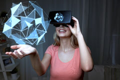 Woman in virtual reality headset or 3d glasses Stock Photos