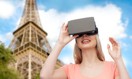 Woman in virtual reality headset or 3d glasses. Technology, virtual reality, entertainment, travel and people concept - happy young woman with virtual reality Royalty Free Stock Images