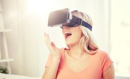 Woman in virtual reality headset or 3d glasses. Technology, virtual reality, cyberspace, entertainment and people concept - happy amazed young woman with virtual Royalty Free Stock Photo