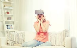 Woman in virtual reality headset or 3d glasses. Technology, virtual reality, cyberspace, entertainment and people concept - happy amazed young woman with virtual Royalty Free Stock Photography