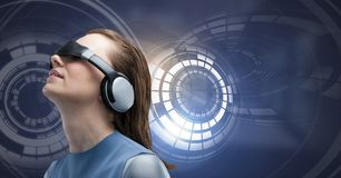 Woman with virtual reality headset and Glowing circle technology interface. Digital composite of Woman with virtual reality headset and Glowing circle technology Royalty Free Illustration