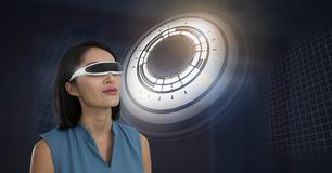 Woman with virtual reality headset and Glowing circle technology interface. Digital composite of Woman with virtual reality headset and Glowing circle technology Royalty Free Stock Photos