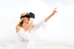 Woman in virtual reality headset pointing finger Royalty Free Stock Images