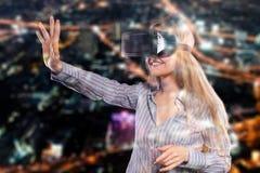 Woman in virtual reality headset Stock Photo