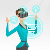 Woman in virtual reality headset shopping online. Royalty Free Stock Image