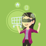 Woman in virtual reality headset shopping online. Royalty Free Stock Images