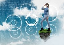 Woman with Virtual reality headset standing on floating rock platform with interfaces in sky. Digital composite of Woman with Virtual reality headset standing on Royalty Free Stock Photography