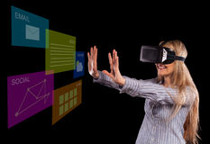 Woman in virtual reality headset Stock Images