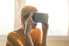 Woman with virtual reality headset Royalty Free Stock Photo