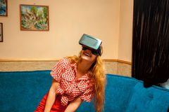 Woman in virtual reality helmet Stock Photography