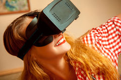 Woman in virtual reality helmet Stock Photo