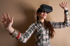 Woman in virtual reality helmet. hands enjoying the experience. Stock Photo