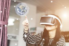 Woman in virtual reality helmet. royalty free stock image