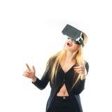 Woman in virtual reality helmet Stock Image
