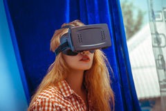 Woman with virtual reality helmet Royalty Free Stock Photos