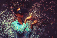 Woman in virtual reality. With VR eyeglasses Royalty Free Stock Images