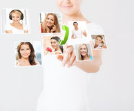 Woman with virtual screen and contact icons Royalty Free Stock Photo