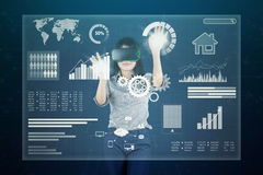Woman with virtual screen and VR headset Royalty Free Stock Photo