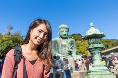 Woman visit Daibutsu in Kamakura Royalty Free Stock Photos