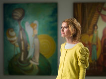 Woman visiting art gallery Royalty Free Stock Images