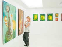 Woman visiting art museum Royalty Free Stock Photo