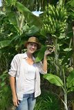 Woman visiting banana plantation Royalty Free Stock Photo