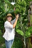Woman visiting banana plantation Stock Photo