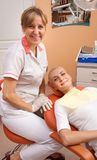 Woman visiting dentist Stock Images