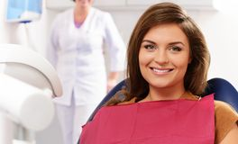 Woman visiting dentist Royalty Free Stock Image