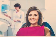 Woman visiting dentist Stock Photos