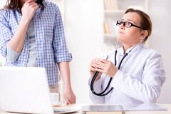 The woman visiting doctor for regular check-up. Woman visiting doctor for regular check-up Stock Photography