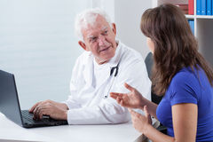 Woman visiting experienced physician. In his office royalty free stock images