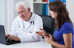 Woman visiting her doctor Stock Images