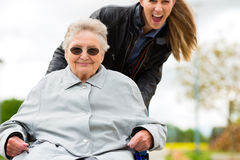 Woman visiting her grandmother Stock Image