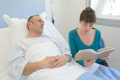 Woman visiting husband in hospital royalty free stock photos