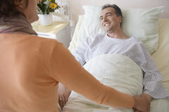 Woman Visiting Man In Hospital Stock Photography