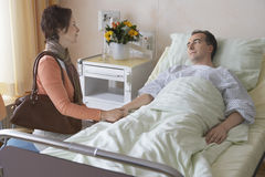 Woman Visiting Man In Hospital Royalty Free Stock Photos