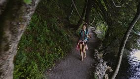 Woman visiting Plitvice Lakes National Park.  stock footage