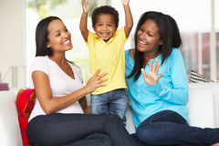 Woman Visiting Pregnant Friend With Son At Home. Smiling To Camera Royalty Free Stock Photo