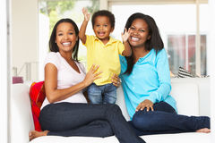 Woman Visiting Pregnant Friend With Son At Home. Smiling To Camera Stock Photos