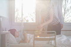 Woman visiting suffering child. Image of women visiting suffering from carcinoma child at hospital Royalty Free Stock Image