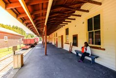Woman visits the Little River train station near akaroa, Christchurch royalty free stock images