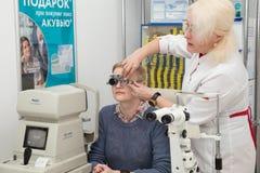 Woman visits optometrist Royalty Free Stock Image