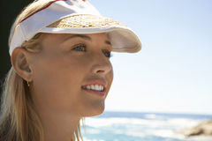 Woman In Visor Cap At Beach. Closeup of beautiful young woman in visor cap at beach Stock Images