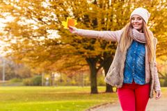 Woman with vitamins for autumn. Medication, health concept. Woman with vitamins for autumn. Attractive lady with long hair wearing warm autumnal clothing Stock Image