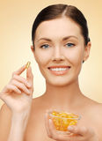 Woman with vitamins Royalty Free Stock Image